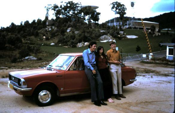 That is me (left) with girlfriend Jennie and school friend Len Limpus (right). It was Mar 21 1971 and I was 19 years old. The Corolla was my first car and I was still in my first year of driving according to the P plate on the front. We were visiting Honeysuckle Creek Tracking station. I knew no one then. Many that work there are now people that I would call friends. The dish (behind the trees) is the one that took the first TV pictures of Amstrong's first steps on the Moon. The dish has been relocated to NASA's deep space Network nearby in Tidbinbilla, ACT, but it has been basically turned into a monument. I Have known my friend Len since Kindergarten and still stay in contact. Jennie I met when I was 18 and also stay in contact.