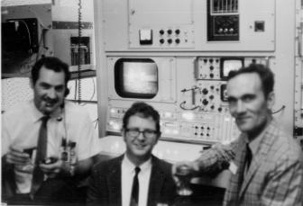 Sydney video scan converter. Photo by Richard Holl left yo right: Ted Knotts, Dick Holl and Elmer Fredd standing in front of the Parkes scan converter at OTC Paddington following the mission